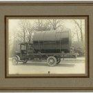 Truck Carrying an Oil Drum Photograph