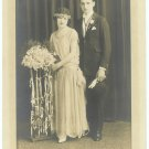 Bride and Monocle-Wearing Groom Wedding Photograph