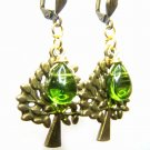 Green glass bead with tree charm antique brass dangle earrings -