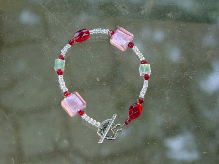 Cute pink, red and clear glass bracelet