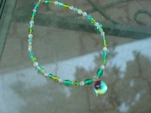 Blue and green beaded necklace with pendant