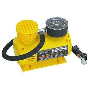12 Volt, 250 PSI Compact Portable Air Compressor Inflator w/3 Extra Nozzles New
