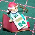 In Box Christmas Traditions Collectible Ornament Holiday Elf Baby With Calendar Matrix