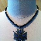cross necklace w/purple and green rhinestones