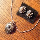 Item 019.  Black and silver  Limpet shell pendant on silver chain with earrings