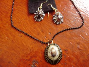 NEW.  Item 027.  Black and gold Limpet shell necklace with matching earrings
