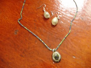 NEW.  Item 030.  Green shell necklace with matching earrings.