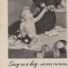 "1953 UTILITY APPLIANCE ""SNUG AS A HUG"" Advertisement"