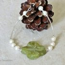 Carved Green Olive Jade Flower, Cream Swarovski Pearls & Sterling Silver Curves Bracelet