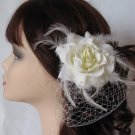 Rose feather fascinator with mini french veil