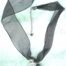 Adjustable Black Organza Ribbon Necklace with Acrylic Daisy Pendant - PreciousThings.ecrater.com