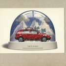 VOLKSWAGEN ADVERTISING POSTCARD SHOWING CAR IN SNOW GLOBE FROM THE UNITED STATES