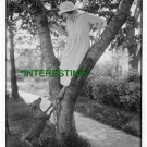 PLAYING WITH A DOG IN A TREE IN 1900 (8x10) ANTIQUE RP DOG PHOTOGRAPH