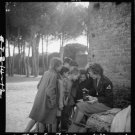 Reproduction Photograph:Favorites: Toni Frissell, Holding Camera, with Children