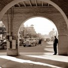 REPRODUCTION ANTIQUE PHOTO:SEPIA: UNKNOW, MAN IN ARCHWAY OLD AUTOMOBILES 1940s?