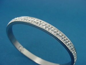 ladies bangle in shiny stainless steel with CZ stones 716