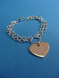 s.steel heart charm bracelet w/rose gold ION plating, double rolo chains 219