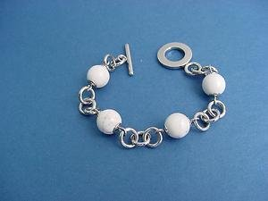 stainless steel bracelet with 4 white howlite gems with T bar and T lock 313