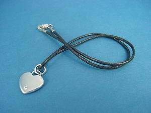 s.steel heart pendant with Swarovski crystal on waxed string and brass lock  576