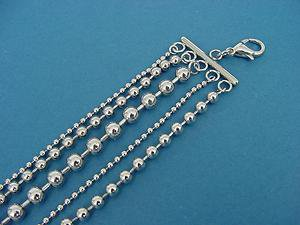 stainless steel bracelet with 5 shiny bead chains 311