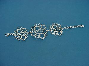 shiny very light stainless steel bracelet with flower relief links 663