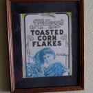 VINTAGE KELLOGGS CORN FLAKES ANNIVERSARY BOX, CUT, MATTED AND FRAMED IN GLASS