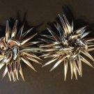 Silver tone star burst earrings