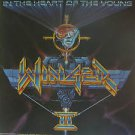 "WINGER usa display IN THE HEART OF THE YOUNG 12"" X 12"" DOUBLE-SIDED POSTER. THIS"
