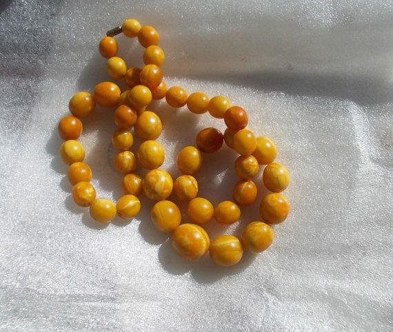 Egg yolk Baltic amber 27 in necklace, 80 gr