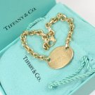 """Return To Tiffany & Co 18K Yellow Gold Oval Tag Charm Bracelet 7.5"""" with box"""