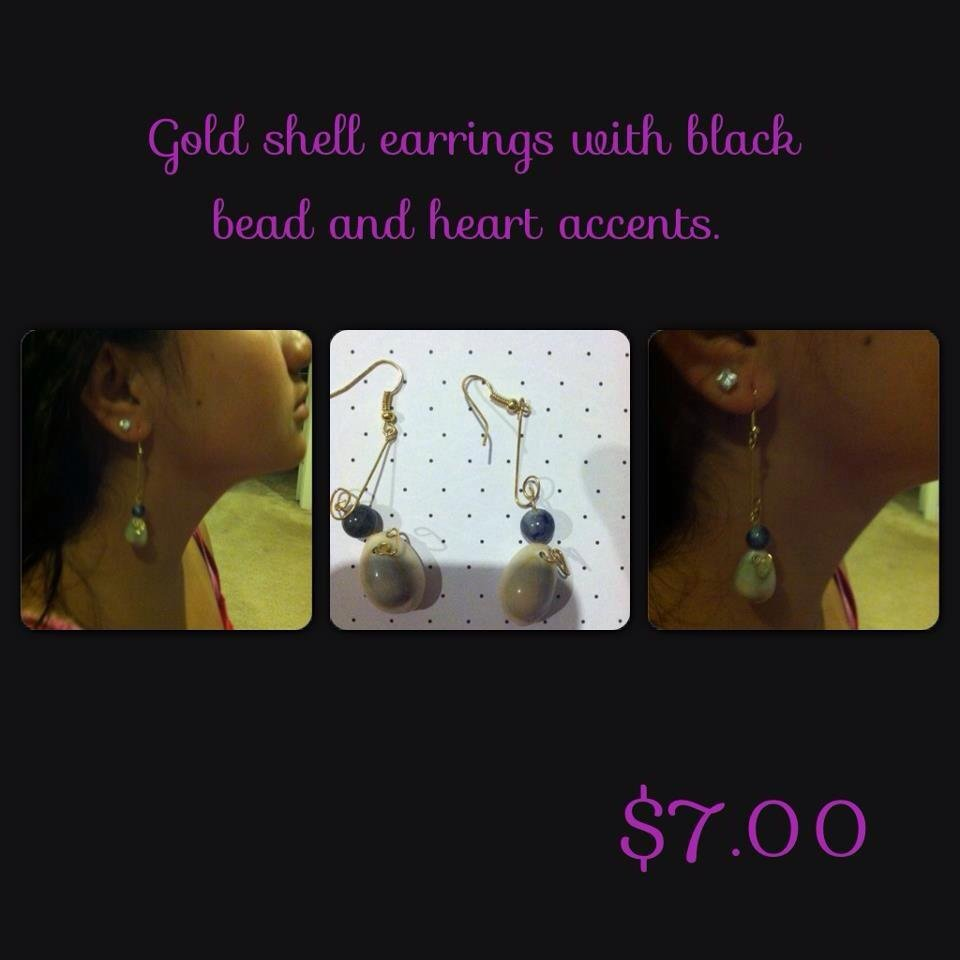 Gold Cowry Shell Earrings with Black Bead Accent.