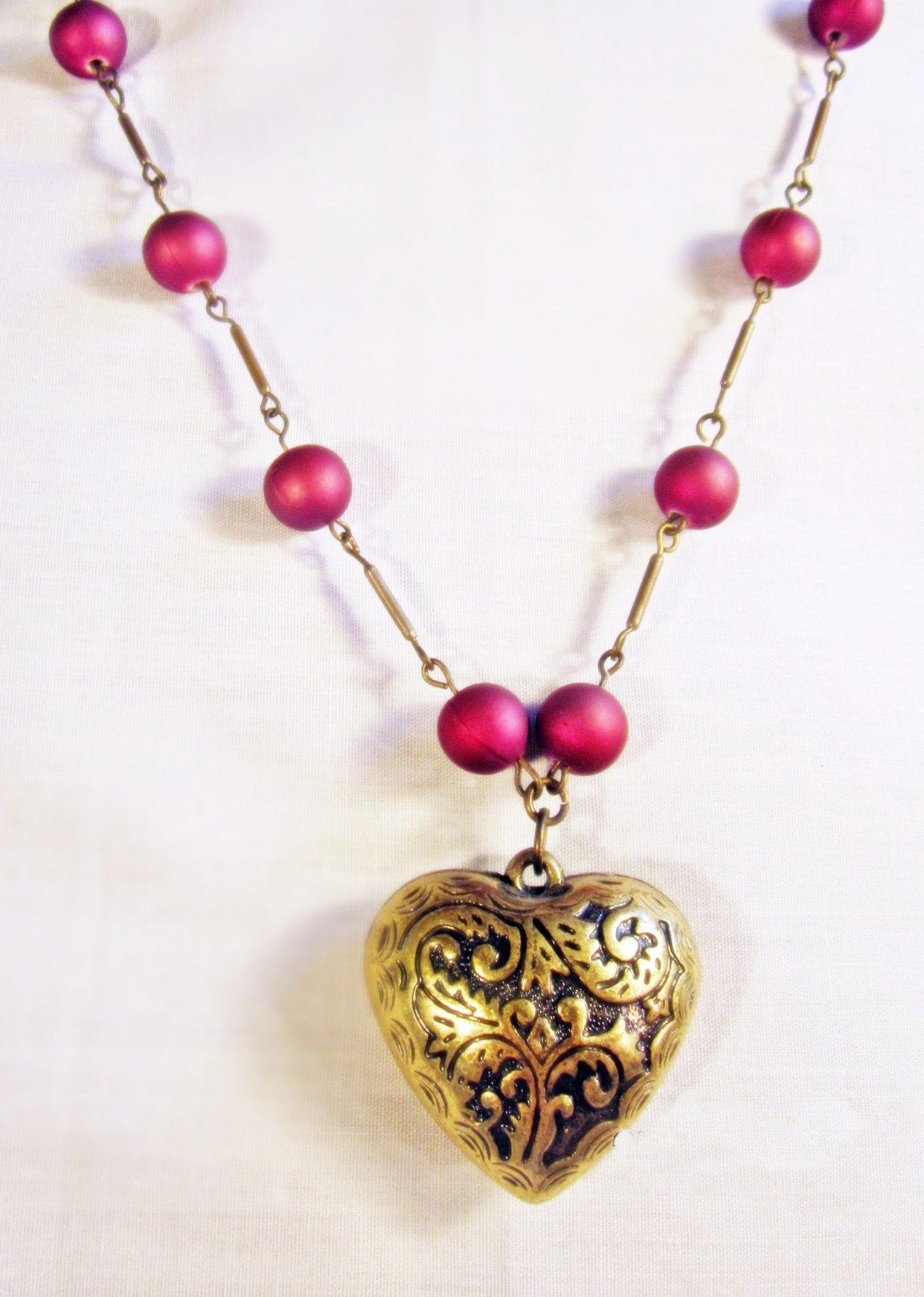 N1 - Purple beaded necklace with heart pendant