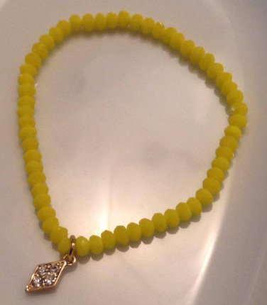 Yellow Faceted Stretch Bracelet with Gold Rhinestone Charm