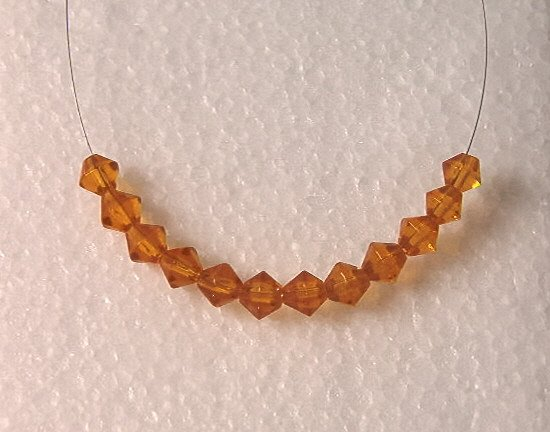 Topaz Cut Glass Crystal Bicones beads (6MM)