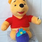 1998 Pooh Plush w/ flowers in pot & butterfly on hand