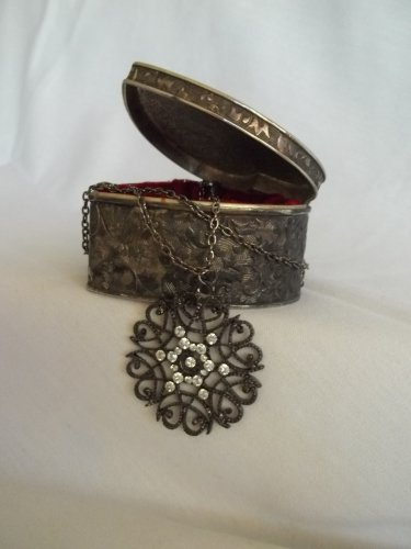 Bohemian carved flower pendant and chain