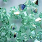 24X 5mm Swarovski 5328 Xilion Crystal Beads Chrysolite AB