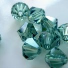 24X 6mm Swarovski 5328 Xilion Crystal Beads Erinite