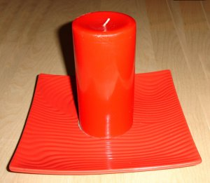 red candle + square red dish