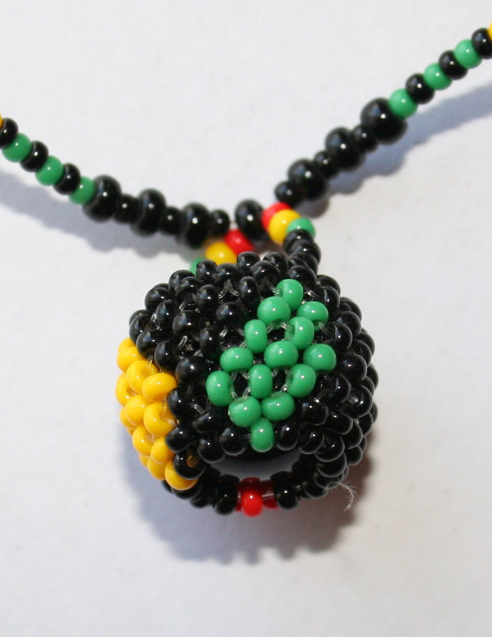 African jewelry beaded ball on bead strand black red for Red black and green jewelry