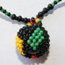 African Jewelry: Beaded Ball on Bead Strand; Black, Red, Yellow, and Green