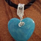 Tagua nut heart with hand woven sterling pendant on cord