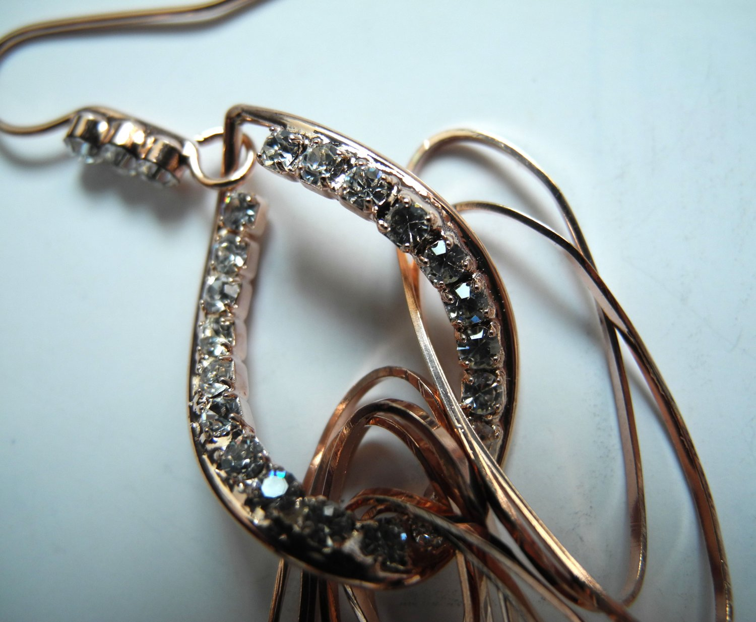 Imitation Rose Gold Plated Earrings detailing with find rhinestones hook type