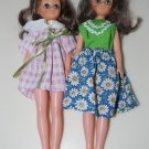 "Two 9"" Dolls with Large Eyes"