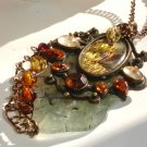 Empress of Autumn Prehnite Paua Garnet Wire wrapped Pendant Necklace