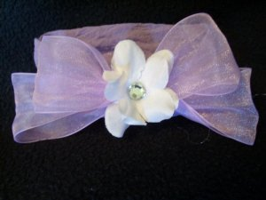 White flower, purple bow, purple band