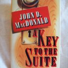 A Key To The Suite. John D. MacDonald, author. Mysterious Press 1st Edition. NF/NF