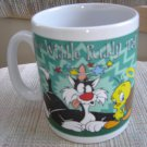 "SYLVESTER & TWEETY ""SUCKER FOR PUNISHMENT/POOR WIDDLE PUDDY TAT"" MUG by WARNER BROS. STORE (1996)!"