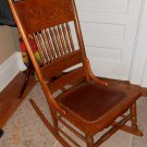 Antique armless rocker with leather seat.