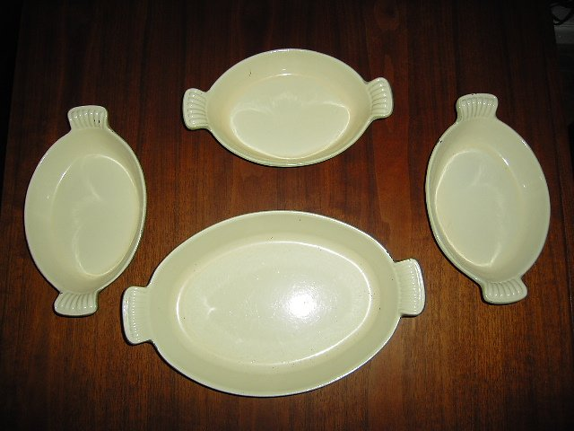 Four Cast iron and enamel cooking saucers by Mse co